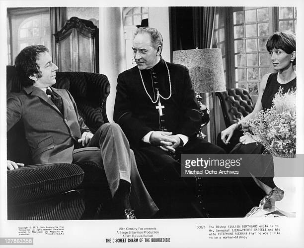 The Bishop Julien Bertheau explains to JeanPierre Cassel and his wife Stephane Audran that he would like to be a workerbishop in a scene from the...