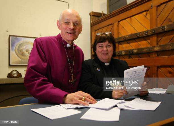 The Bishop of Dover the Rt Rev Trevor Willmott with the Assistant Curate of All Saints Church in Murston Rev Lesley Jones stand behind the counter of...
