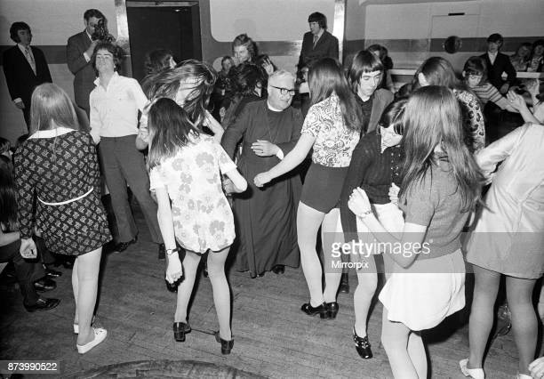 The Bishop of Durham Dr Ian Ramsey dancing with fifteenyearold Isobel Brennan from Jarrow at the 'Change Is' discotheque in Newcastle upon Tyne 4th...
