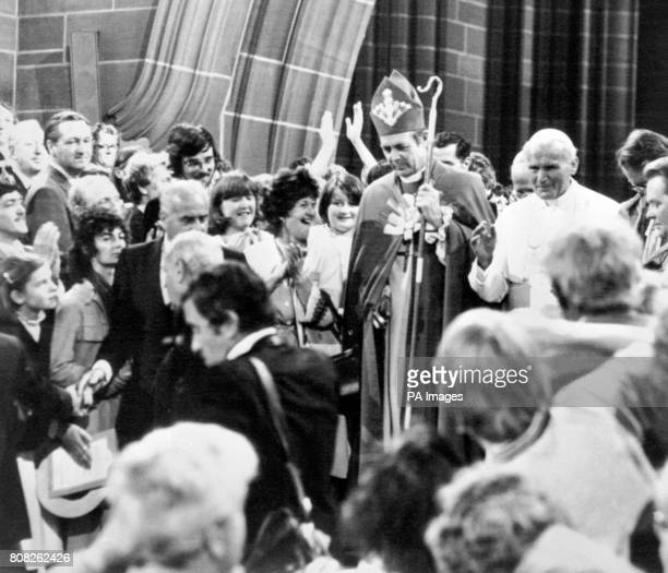The Bishop of Liverpool the Right Reverend David Sheppard escorts Pope John  Paul II through the