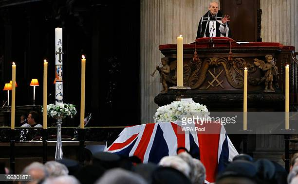The Bishop of London Richard Chartres delivers an address near the coffin containing the body of former British Prime Minister Margaret Thatcher...