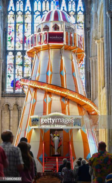 The Bishop of Lynn, the Rt Revd Jonathan Meyrick as he gives his sermon from the helter skelter inside the nave of the cathedral on August 18, 2019...