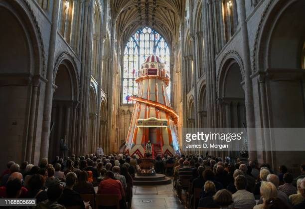 The Bishop of Lynn the Rt Revd Jonathan Meyrick as he gives his sermon from the helter skelter inside the nave of the cathedral on August 18 2019 in...
