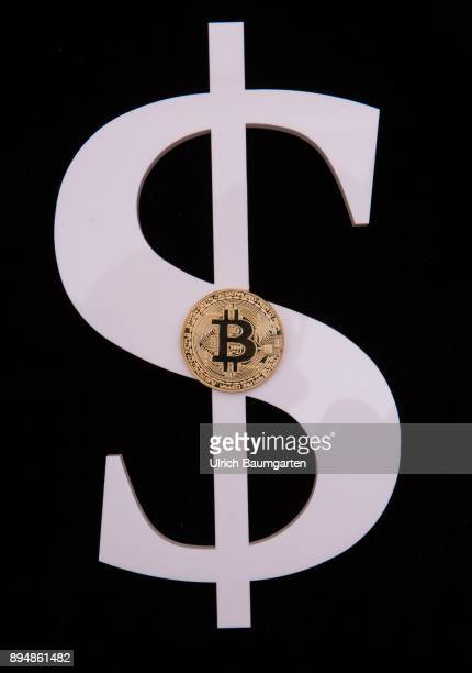 The Bitcoin has the twenty thousand dollar mark in view The photo shows the dollar symbol and a Bitcoin