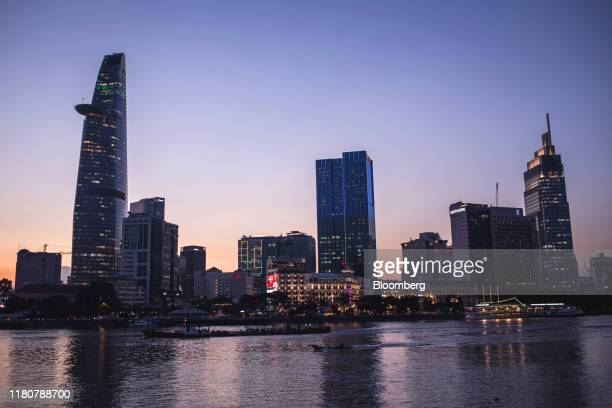 The Bitexco Financial Tower left the Saigon Times Square building center the Vietcombank Tower right and other commercial buildings stand along...