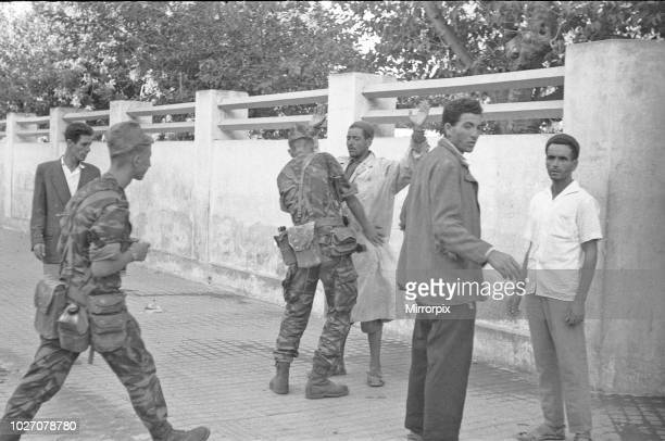 The Bizerte Crisis 1961 French soldiers search an arab man on the the streets of Bizerte after they had overwhelmed the city. 24th July 1961.