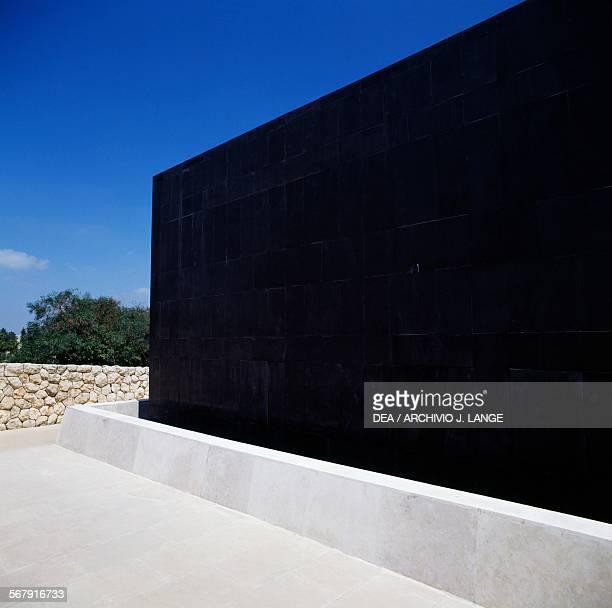 The black basalt monolith in front of the Shrine of the Book where the Dead Sea Scrolls are kept Jerusalem Israel Jerusalem Israel Museum