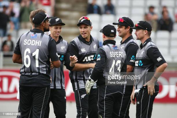 The Black Caps celebrate a wicket during game five of the Twenty20 International series between New Zealand and England at Eden Park on November 10...