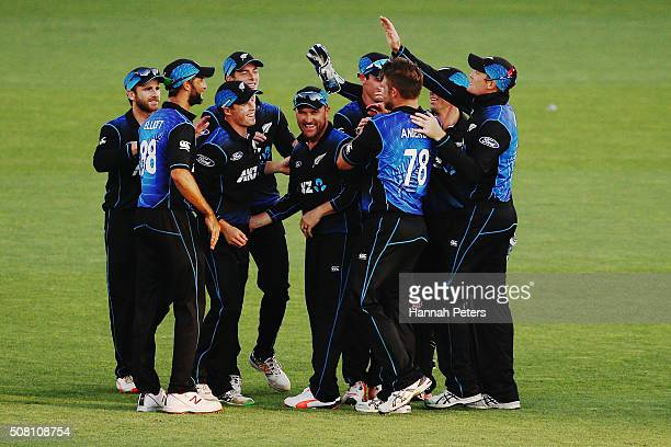 The Black Caps celebrate the wicket of Matthew Wade of Australia during the One Day International match between New Zealand and Australia at Eden...