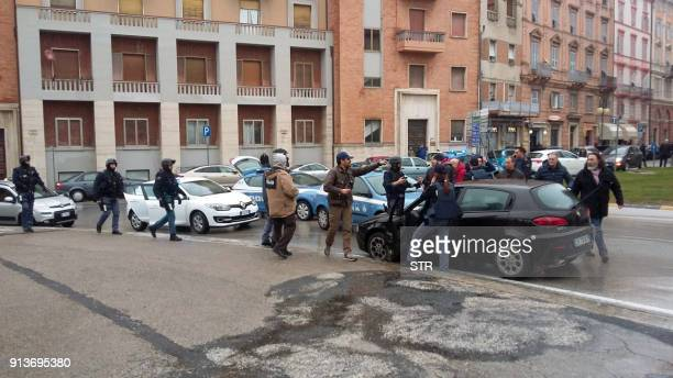The black car Alfa Romeo of young man suspected of wounding several foreign nationals in a driveby shootingis blocked by police and Carabibieri...