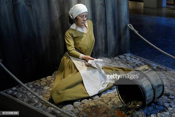 The Black Death 14th century Epidemic that ravaged the European continent Figure of a woman hit by plague Medieval Museum Stockholm Sweden