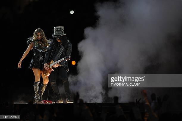 The Black Eyed Peas and guitarist Slash perform during halftime at the NFL Super Bowl XLV football game between the Green Bay Packers and the...