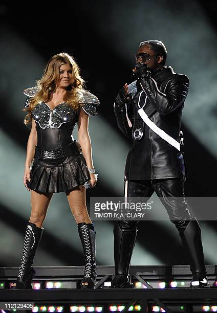 The Black Eyed Peas perform during halftime at the NFL Super Bowl XLV football game between the Green Bay Packers and the Pittsburgh Steelers on...