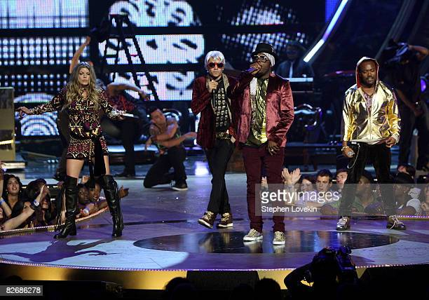 The Black Eyed Peas perform on stage during the Conde Nast Media Group's Fifth Annual Fashion Rocks at Radio City Music Hall on September 5 2008 in...