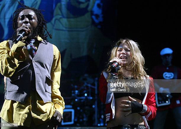 The Black Eyed Peas perform on the Pyramid stage at Worthy Farm Pilton Somerset at the 2004 Glastonbury Festival 26 June 2004 The festival spans over...