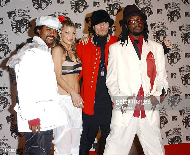 The Black Eyed Peas pose backstage during the 2003 MTV Europe Music Awards at Ocean Terminal on November 6 2003 in Edinburgh Scotland