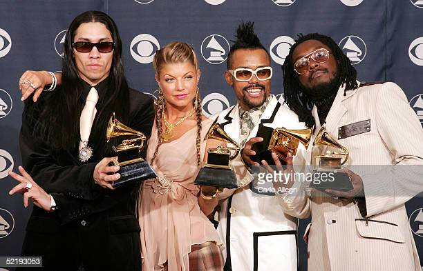 """The Black Eyed Peas, Taboo , Fergie, and Apl.De.Ap, Will.I.Am pose backstage with their award for """"Best Rap Performance by a Duo or Group"""" for their..."""