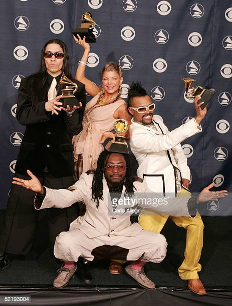 The Black Eyed Peas Taboo Fergie WillIAm and AplDeAp pose backstage with their award for Best Rap Performance by a Duo or Group for their song That's...
