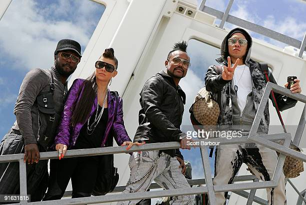 The Black Eyed Peas william Fergie apldeap and Taboo pose in front of an aeroplane before the 'Mile High Club' InFlight Karaoke gig on a flight from...