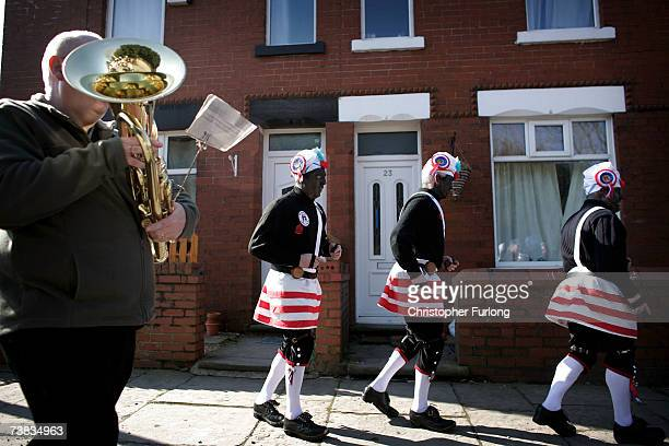 The black faced Morrismen of the Britannia Coconutters dance boundary to boundary in Bacup on April 7 2007 in Lancashire northern England Every...