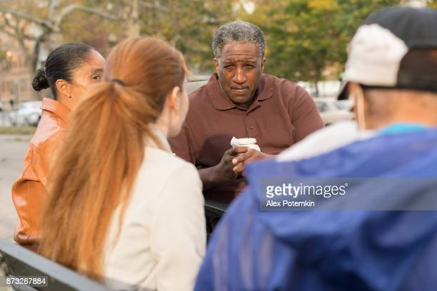 the black family with the white teenager girl hanging in the square in bronx - lap body area stock photos and pictures