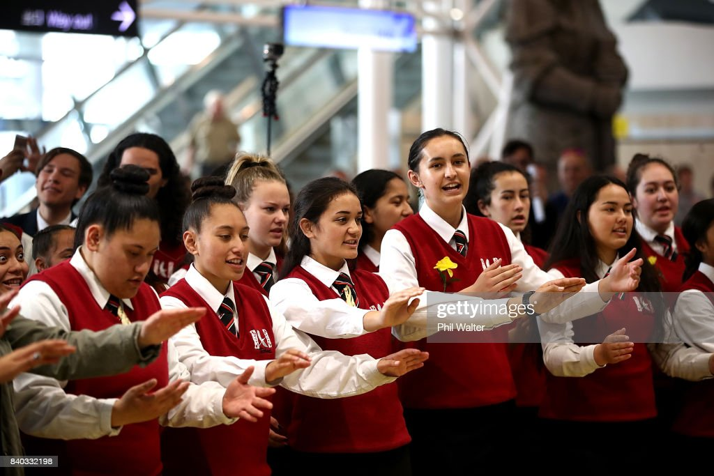 The Black Ferns are welcomed with a cultural school group as they arrive at Auckland International Airport on August 29, 2017 in Auckland, New Zealand. New Zealand won the 2017 Women's Rugby World Cup by defeating England in the Final in Belfast.