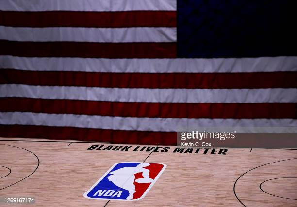 The Black Lives Matter logo is seen on an empty court as all NBA playoff games were postponed today during the 2020 NBA Playoffs at The Field House...