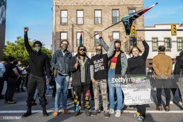 The Black Lives Matter organization, the Downtownerz, poses for a photo during a protest against the police killing of Ma'Khia Bryant. Black Lives...