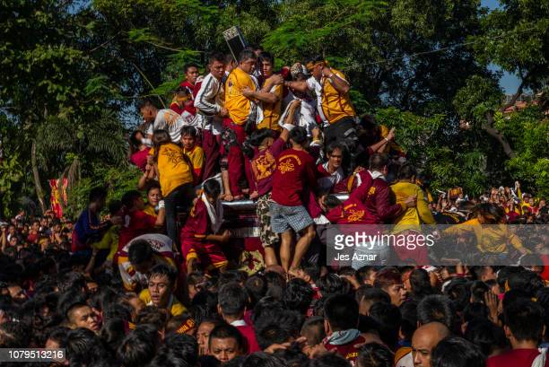 The Black Nazarene during the procession as devotees fight to climb and touch the image on January 9 2019 in Manila Philippines The Black Nazarene is...