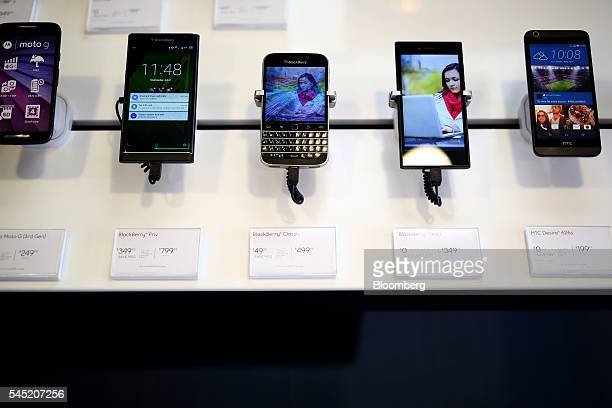The BlackBerry Ltd Classic smartphone center sits on display at a store in Waterloo Ontario Canada on Wednesday July 6 2016 BlackBerry will no longer...