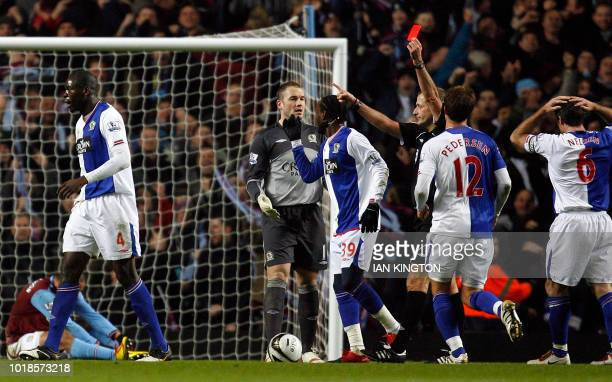 The Blackburn Rovers' Congolese player Christopher Samba is sent off by referee Martin Atkinson for a challenge on Aston Villa's Gabriel Agbonlahor...