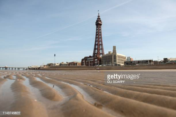 The Blackpool Tower, an iconic British landmark and tourist attraction, is seen from the beach on the 125th anniversary of it opening to the public,...