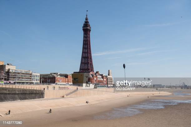 The Blackpool Tower an iconic British landmark and tourist attraction is pictured on the 125th anniversary of the tower's opening to the public in...