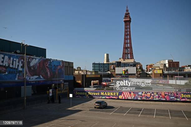The Blackpool Tower is seen behind a near-empty car park in the spring sunshine in Blackpool, north-west England on April 13 during the nationwide...