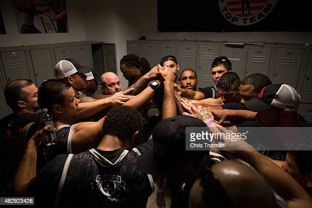 The Blackzilians huddle together after their loss to American Top Team during the filming of The Ultimate Fighter: American Top Team vs Blackzilians...