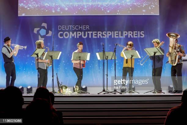 """The """"Blaeser Sechstett der Hochschule für Musik Hanns Eisler Berlin"""" perform during the German Computer Games Award 2019 at Admiralspalast on April..."""