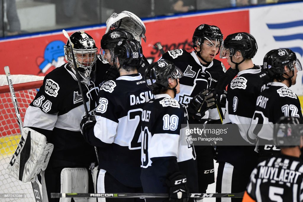 The Blainville-Boisbriand Armada celebrate their victory against the Drummondville Voltigeurs during the QMJHL game at Centre d'Excellence Sports Rousseau on October 27, 2017 in Boisbriand, Quebec, Canada. The Blainville-Boisbriand Armada defeated the Drummondville Voltigeurs 2-0.