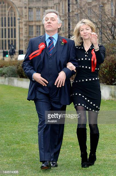 British actor and comedian Rik Mayall as Alan B'Stard and actress Marsha Fitzalan during a photocall for The New Statesman Episode 2006 The Blair...