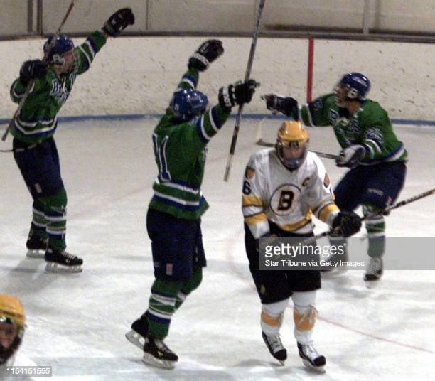 The Blake hockey team celebrates after scoring a first period goal against Breck