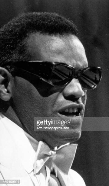 The blind soul singer and musician Ray Charles wearing dark glasses and a white tuxedo and bow tie Los Angeles California 1963