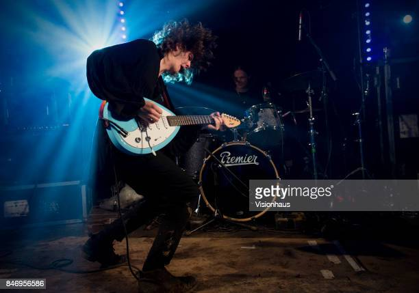 The Blinders with Thomas Haywood on guitar and vocals Charlie McGough on bass and Matt Neale on drums perform on the House Party stage at Kendal...