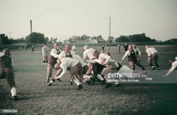 The blocker clears the path for the ballcarrier during a high school football game circa 1939.
