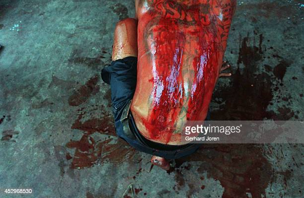The blood stained back of one of 200 inmates that performed self flagellation on Good Friday. The ritual is to show repent for their crimes and to...