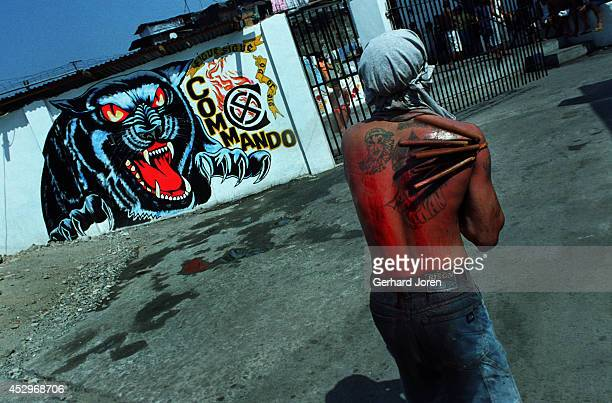 The blood stained back of one of 200 inmates that performed self flagellation on Good Friday The ritual is to show repent for their crimes and to...