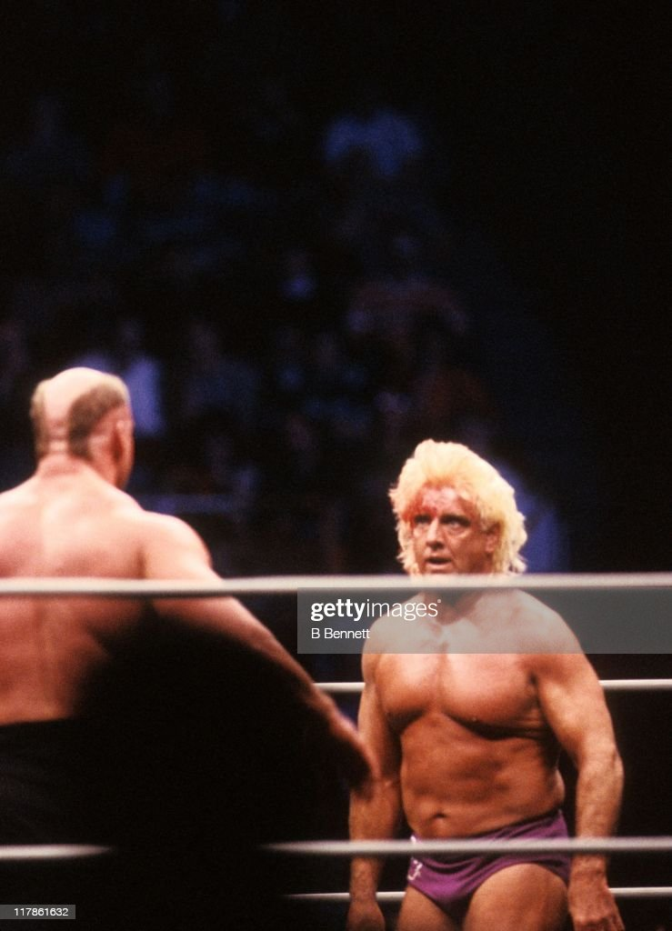 The bloodied 'Nature Boy' Rick Flair backs down from Road Warrior Hawk during their Heavy Weight bout at the 1988 Bunkhouse Stampede on January 24, 1988 at the Nassau Coliseum in Uniondale, New York.