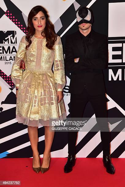The Bloody Beetroots Levante pose on the red carpet of the 2015 MTV Europe Music Awards at Mediolanum Forum on October 25 2015 in Milan AFP PHOTO /...