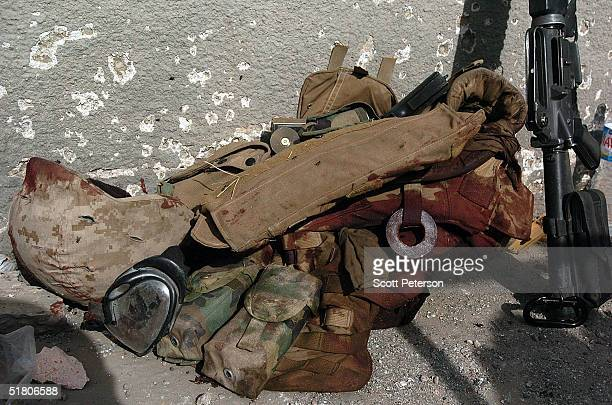 The bloody flak vest of a US Marines from the 1st Battalion 3rd Marines lies on the floor after a battle leaving three insurgents one marine dead and...