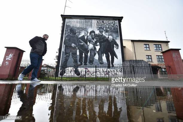 The Bloody Sunday mural depicting the body of Jackie Duddy being carried away after his shooting alongside Bishop Edward Daly is seen in the...