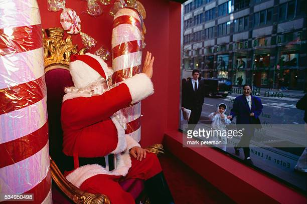 The Bloomingdale's Santa Claus waves to passerbyers in Manhattan Now children can send their Christmas lists to Santa via email