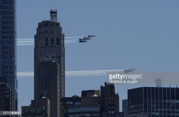 The Blue Angels and Thunderbirds fly over New York in a salute to health care workers on April 28, 2020. - The US Navy Blue Angels and Air Force...